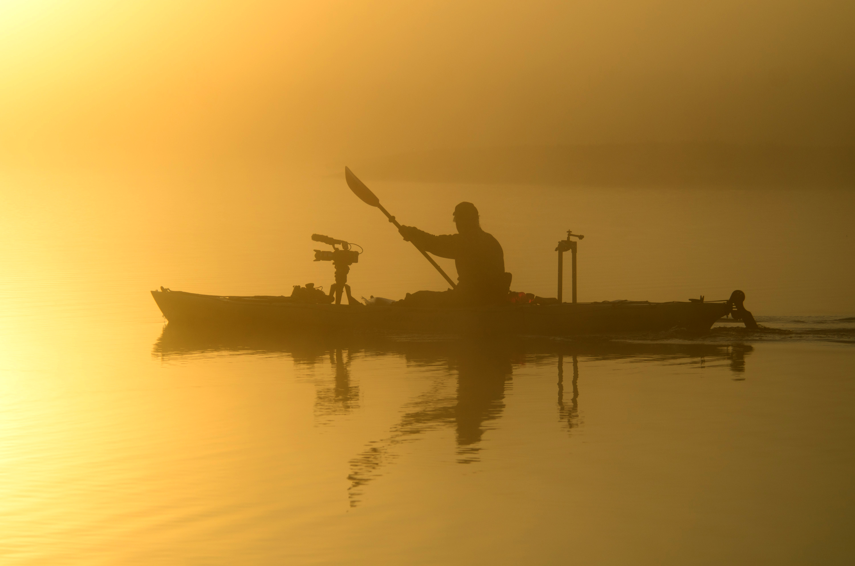 Elam on kayak filming the morning sunrise on the St. Johns River. Image by Carlton Ward, Jr. 2012 copyright.