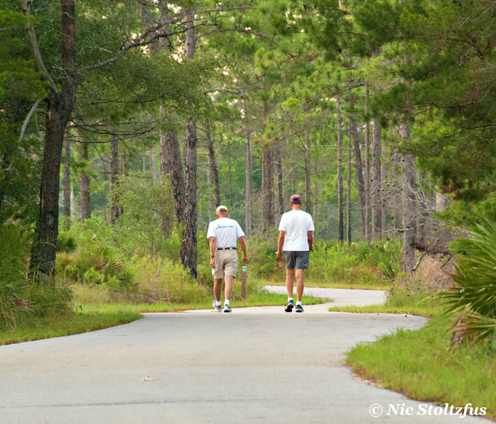 Two friends taking a morning walk at Topsail Hill Preserve State Park.