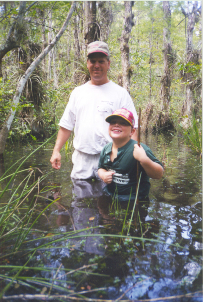 Nic on a swamp walk with his dad, Elam.